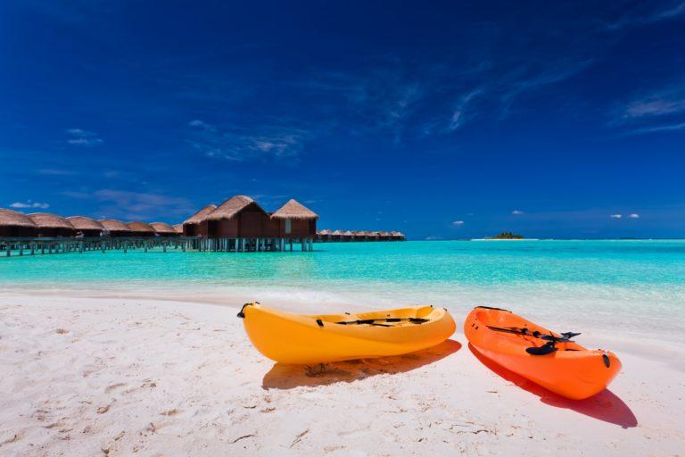 Colourful kayaks on the tropical beach
